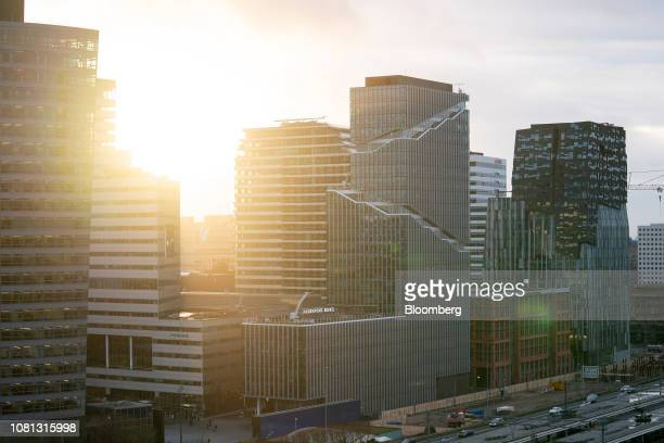The sun sets behind office and commercial property at dusk in the Zuidas financial district in Amsterdam Netherlands on Friday Jan 11 2019 A large...