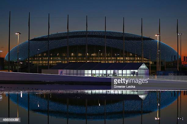 The sun sets behind the Bolshoy Ice Dome ahead of the Sochi 2014 Winter Olympics at the Olympic Park on February 2 2014 in Sochi Russia