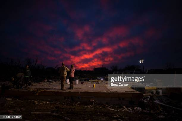 The sun sets behind the foundation of a home left after a tornado early Tuesday morning on March 4 2020 in Cookeville Tennessee A tornado passed...
