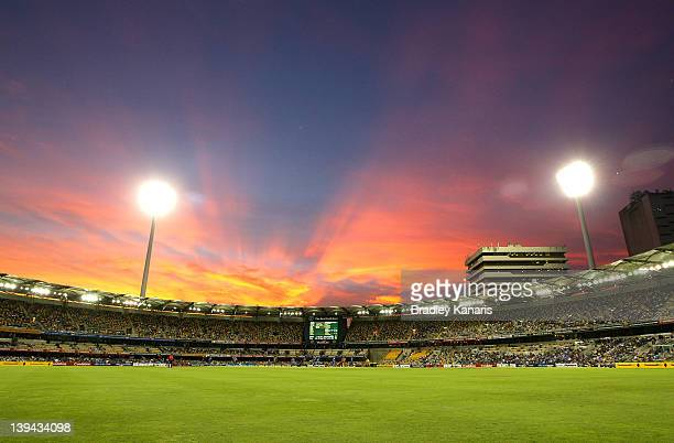 The sun sets behind the Gabba stadium during game eight of the One Day International Series between India and Sri Lanka at The Gabba on February 21,...
