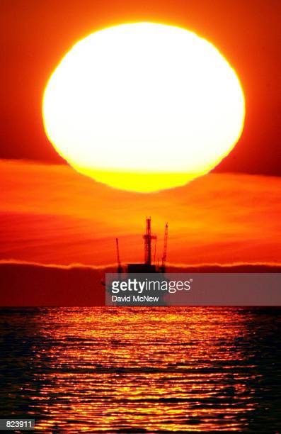 The sun sets behind the Hillhouse A oil and gas platform near the Federal Ecological Reserve in the Santa Barbara Channel February 15 near Santa...