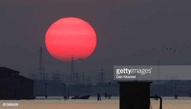 The sun sets behind the mainland during the 65th Venice Film Festival on August 28 2008 in Venice Italy
