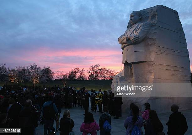 The sun sets behind the Martin Luther King Jr Memorial during a candlelight vigil and wreath laying to honor and remember the life of Dr King on the...