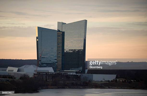 The sun sets behind the Mohegan Sun casino in Uncasville Connecticut on Sunday Jan 13 2008 Bondholders in Connecticut's Mohegan Sun and Foxwoods...