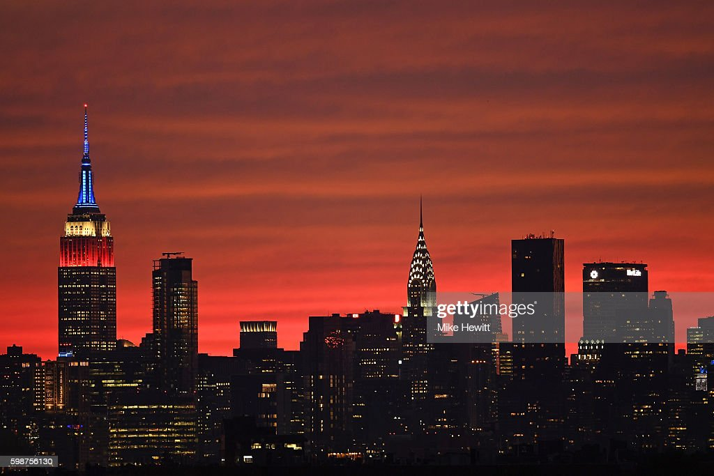 The sun sets behind the New York skyline on Day Five of the 2016 US Open at the USTA Billie Jean King National Tennis Center on September 2, 2016 in the Flushing neighborhood of the Queens borough of New York City.