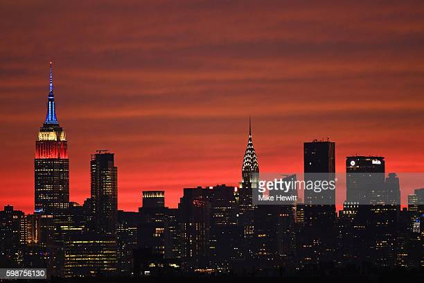 The sun sets behind the New York skyline on Day Five of the 2016 US Open at the USTA Billie Jean King National Tennis Center on September 2 2016 in...