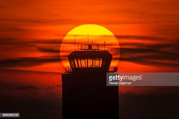 The sun sets behind the old tower of the airport Schoenefeld on September 29 2017 in Berlin Germany