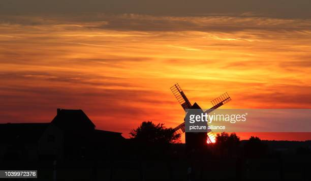 The sun sets behind the old wind mill 'Sommerfeld' in Tiefensee Germany 02 October 2013 The wind mill was built in 1847 and has been owned by the...