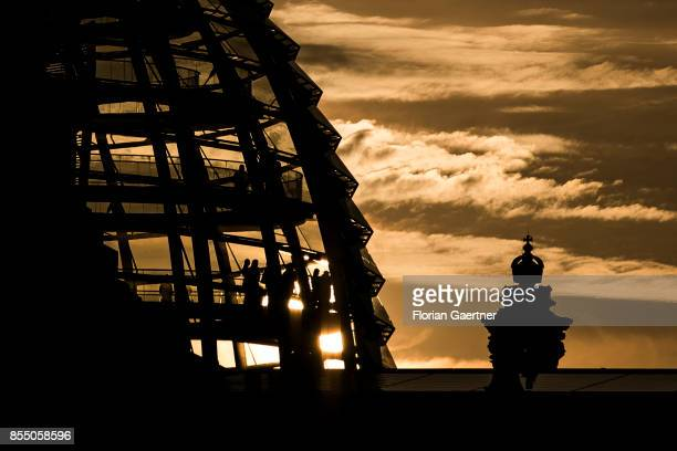 The sun sets behind the Reichstag Building on September 27 2017 in Berlin Germany
