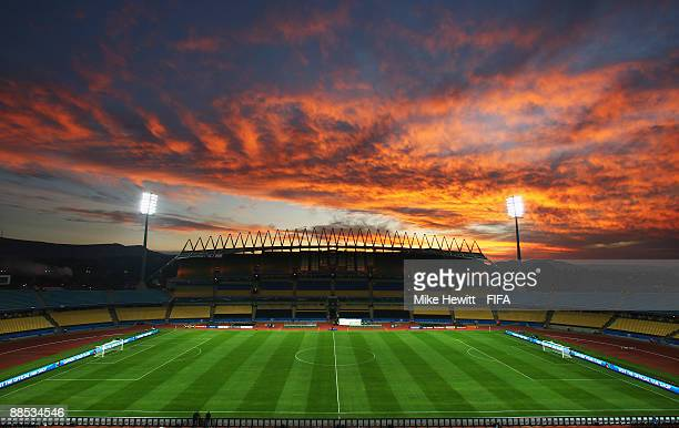 The Sun sets behind the Royal Bafokeng Stadium before the start of the FIFA Confederations Cup Group A match between South Africa and New Zealand at...
