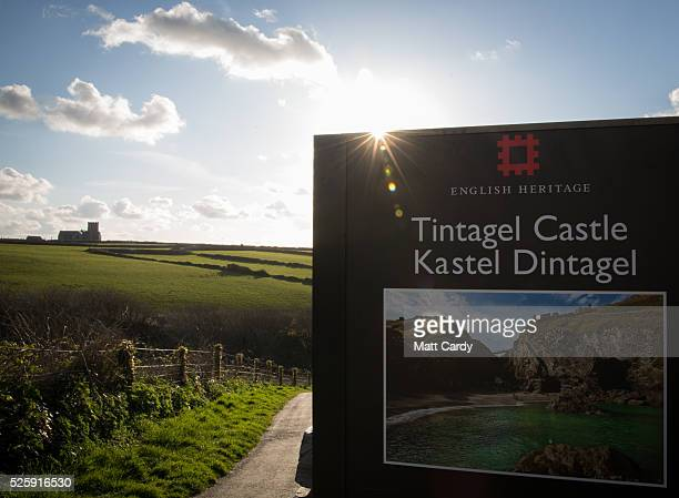 The sun sets behind the sign for Tintagel Castle on April 27 2016 in Cornwall England The English Heritage managed site and the nearby town have long...