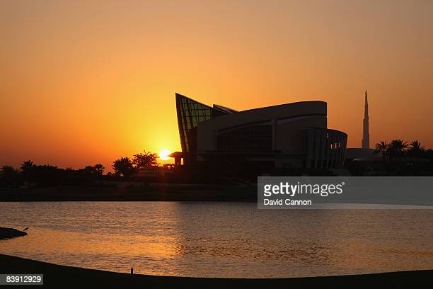 The sun sets behind the skyline of Dubai and the World's tallest building The Burj Dubai and the clubhouse taken from the par 4 18th tee at the Four...
