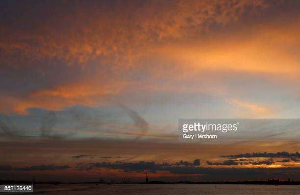 The sun sets behind the Statue of Liberty in New York City on September 21 2017