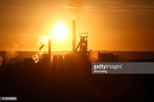 The sun sets behind the steel works operated by Tata Steel Ltd. In Port Talbot, U.K. On Thursday, March 31, 2016. Tata Steel, part of India's biggest...