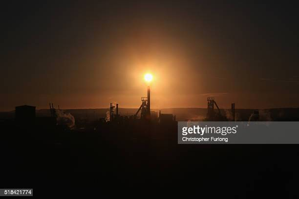 The sun sets behind the Tata Steel plant at Port Talbot on March 31 2016 in Port Talbot Wales Indian owners Tata Steel has put its British business...