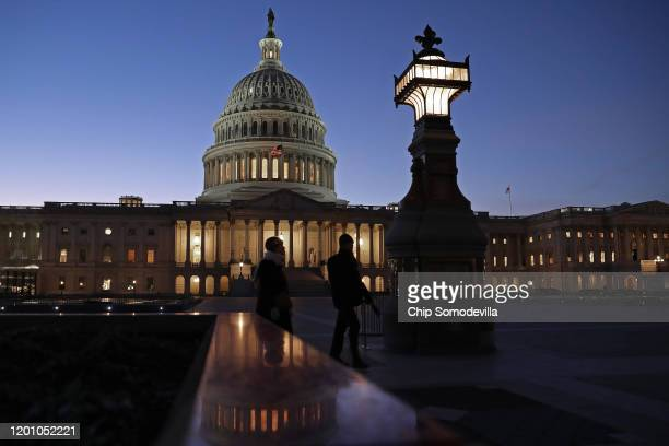 The sun sets behind the US Capitol Dome during the first evening of President Donald Trump's impeachment trial January 21 2020 in Washington DC...