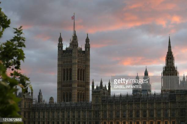 The sun sets behind the Victoria Tower part of the Palace of Westminster home to the Houses of Parliament on May 11 as life in Britain continues...