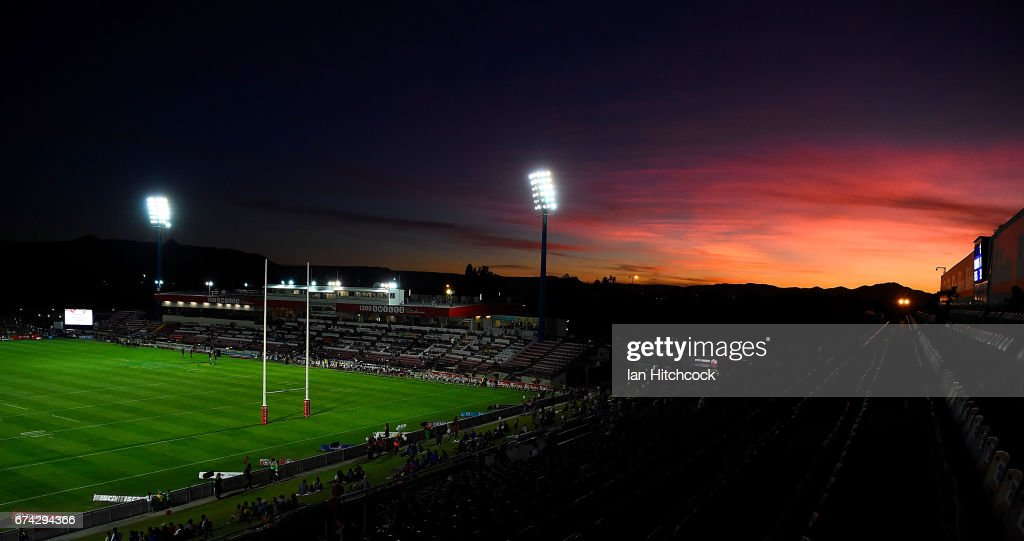 The sun sets behind the western and northern grandstands before the start of the round nine NRL match between the North Queensland Cowboys and the Parramatta Eels at 1300SMILES Stadium on April 28, 2017 in Townsville, Australia.