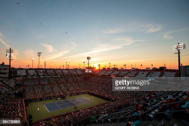 TOPSHOT The sun sets behind Uniprix Stadium in Montreal Quebec July 30 2016 as Elena Vesnina and Ekaterina Makarova of Russia take on Christina...
