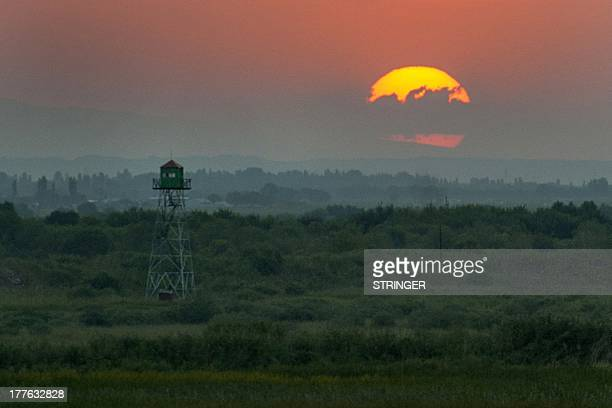 The sun sets down over the border between Armenia and Turkey not far from the village of Khor Virap some 50 kms from Yerevan on August 24 2013 AFP...