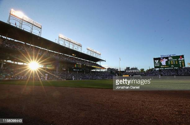 The sun sets during a game between the Chicago Cubs and the Atlanta Braves at Wrigley Field on June 24 2019 in Chicago Illinois
