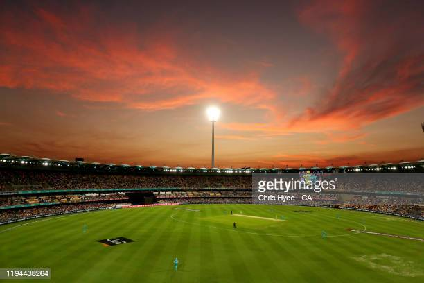 The sun sets during the Big Bash League match between the Brisbane Heat and the Sydney Thunder at The Gabba on December 17, 2019 in Brisbane,...
