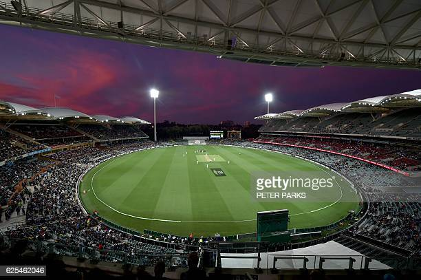 The sun sets during the first innings of the daynight third Test cricket match between Australia and South Africa at the Adelaide Oval in Adelaide on...