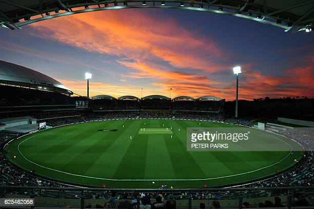 TOPSHOT The sun sets during the first innings of the daynight third Test cricket match between Australia and South Africa at the Adelaide Oval in...