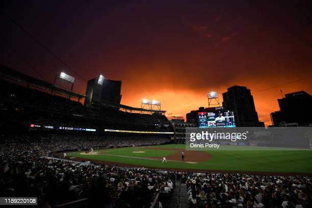 The sun sets during the third inning of a baseball game between the San Diego Padres and the St. Louis Cardinals at Petco Park June 29, 2019 in San...