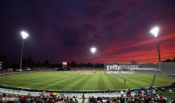 The sun sets during the Twenty20 Tri Series international cricket match between New Zealand and England at Seddon Park in Hamilton on February 18,...