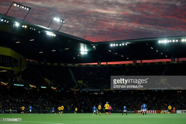The sun sets during the UEFA Europa League group G football match between Young Boys and Glasgow Rangers at the Stade de Suisse stadium on October 3...