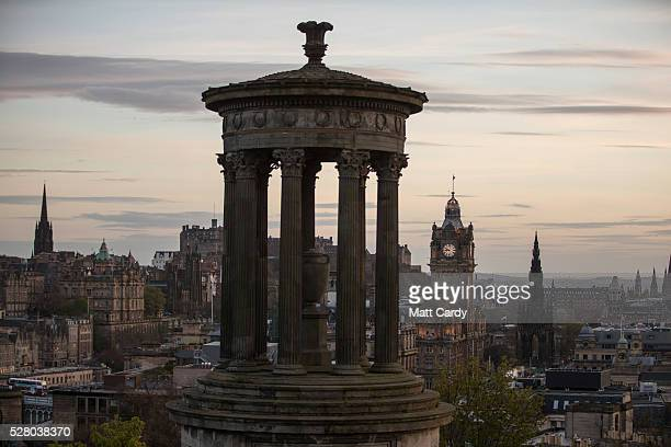 The sun sets Edinburgh with the Dugald Stewart Monument in the foreground on May 3, 2016 in Edinburgh, Scotland. As campaigning for the Holyrood...