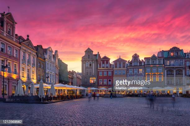 the sun sets in the old town of poznan - poland stock pictures, royalty-free photos & images