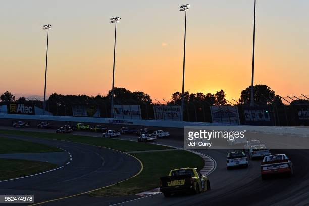 The sun sets in turn four during the NASCAR Camping World Truck Series Villa Lighting delivers the Eaton 200 at Gateway Motorsports Park on June 23...