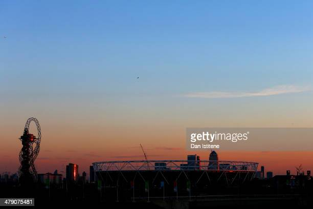The sun sets next to the Olympic Stadium and the ArcelorMittal Orbit inside the Olympic Park before Revolution 5 at the Velodrome in the Lee Valley...