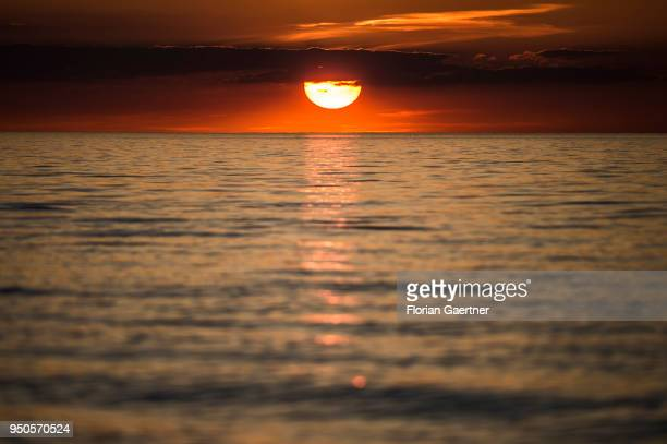 The sun sets on April 21 2018 in Warnemuende Germany
