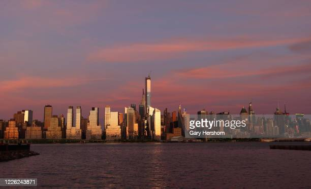 The sun sets on Central Park Tower on Billionaires' Row and the west side of Manhattan in New York City on May 20, 2020 as seen from West New York,...
