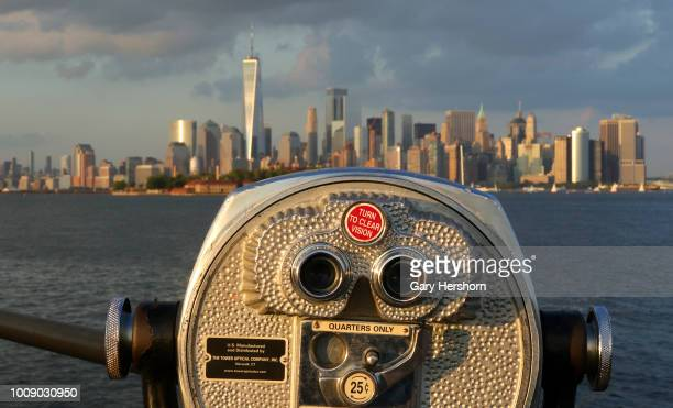 The sun sets on lower Manhattan and One World Trade Center in New York City on July 26 2018 as seen from Liberty State Park in Jersey City New Jersey