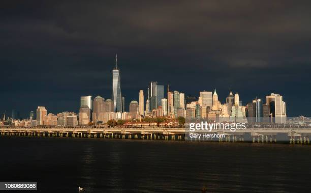 The sun sets on lower Manhattan and One World Trade Center in New York City on October 28 2018 as seen from Liberty State Park in Jersey City New...