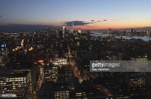 The sun sets on lower Manhattan as seen from the 56th floor of the Madison Square Park Tower on January 30, 2017 in New York City.
