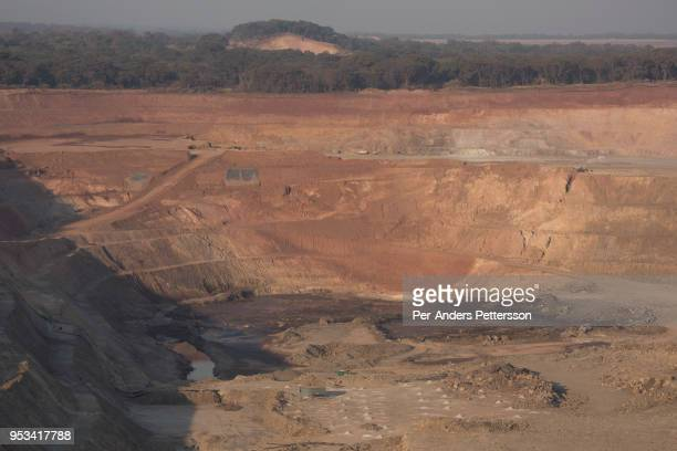 The sun sets on one of the open pit copper mines at Mutanda Mining Sarl on July 6 2016 in Kolwezi DRC The mine is owned by Glencore an AngloSwiss...