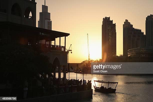 The sun sets on the Burj Khalifa Lake on April 9, 2014 in Dubai, United Arab Emirates. At 2,722 ft, the Burj Khalifa building is the world's tallest...