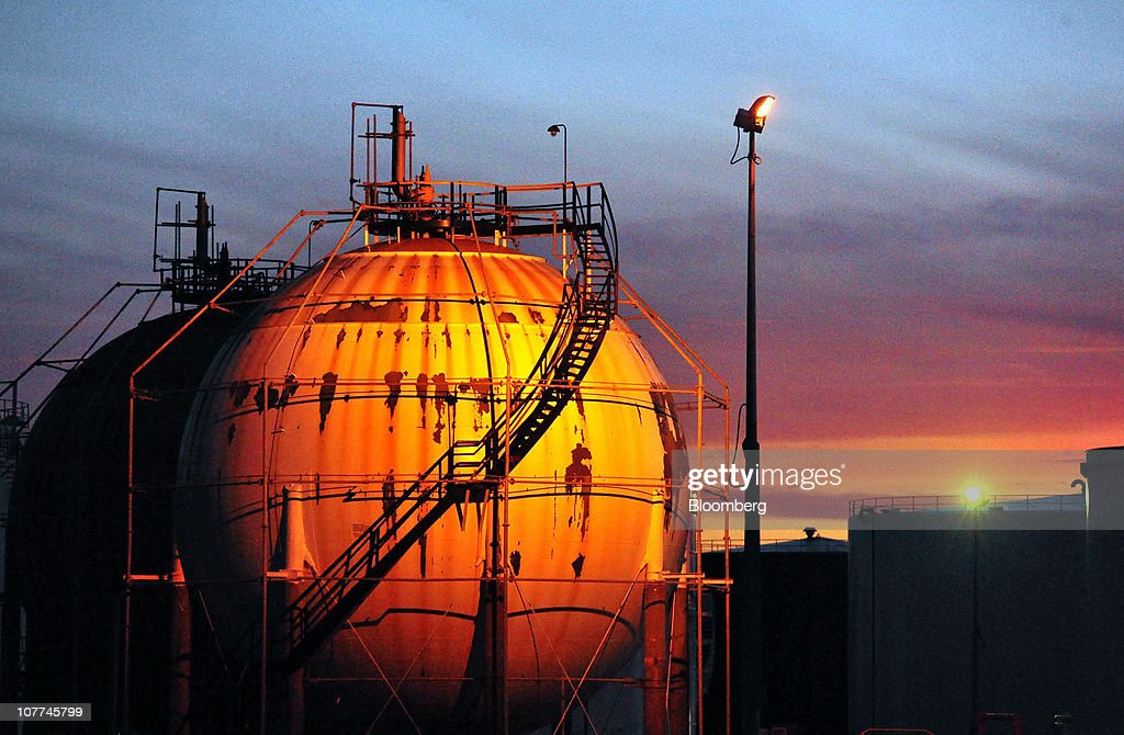 The sun sets on the butane storage spheres at Caltex Australia Ltd.'s Lytton refinery in Brisbane, Australia, on Tuesday, Dec. 21, 2010. Caltex Australia is the nation's biggest oil refiner. Photographer: Eric Taylor/Bloomberg via Getty Images