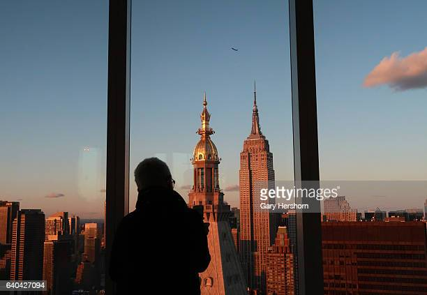 The sun sets on the Empire State Building as seen from the 56th floor of the Madison Square Park Tower on January 30, 2017 in New York City.
