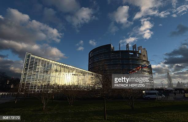 The sun sets on the European Parliament in Strasbourg eastern France on February 3 2016 / AFP / PATRICK HERTZOG