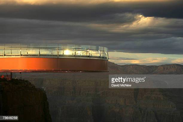 The sun sets on the evening of the first official walk on the Skywalk billed as the firstever cantilevershaped glass walkway extending 70 feet from...