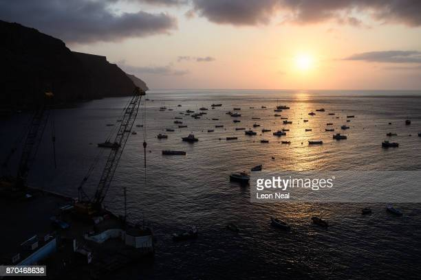 The sun sets on the harbour on October 23 2017 in Jamestown Saint Helena Following the introduction of weekly flights to the island resident St...