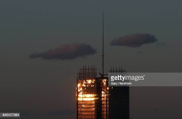 The sun sets on the New York Times buidling as seen from the 56th floor of the Madison Square Park Tower on January 30, 2017 in New York City.
