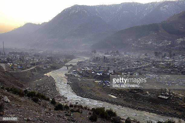 The sun sets on the partially ruined Pakistani Kashmiri city of Balakot 09 January 2006 two days ahead of the Muslim festival of Eid alAdha the feast...