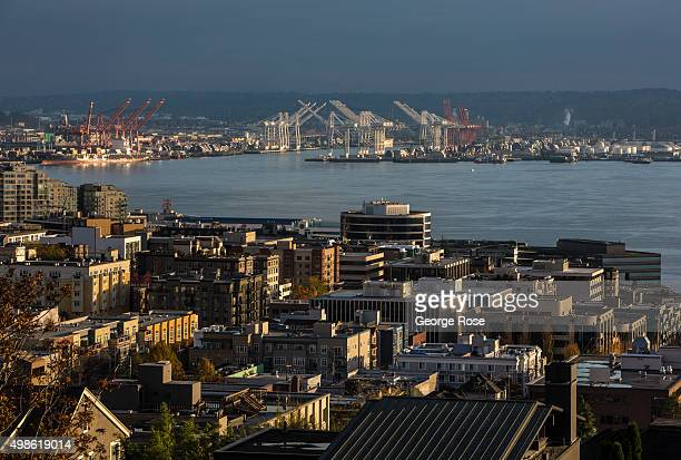 The sun sets on the Port of Seattle and downtown waterfront as viewed from Queen Anne Hill on November 4 in Seattle Washington Seattle located in...